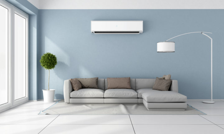 air conditioner on blue wall above grey couch