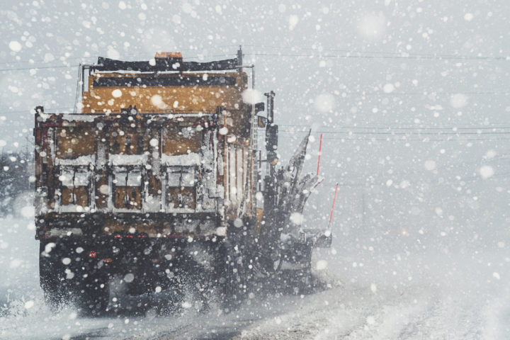 Snow plow on road