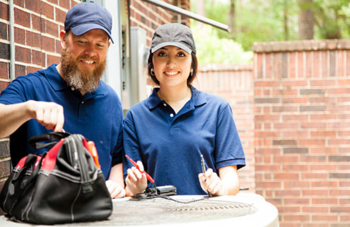 Man and woman HVAC workers